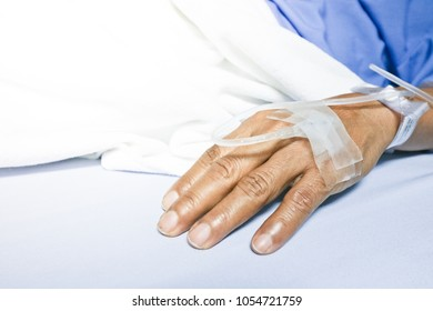 soft focus Saline intravenous (IV) drip in a Asian woman patient hand Treatment in the hospital