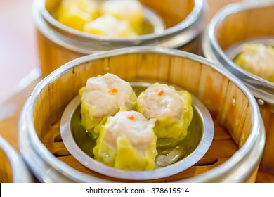Soft of Focus : Siu Mai / Dim sum - Chinese steamed pork dumplings in bamboo steamers.