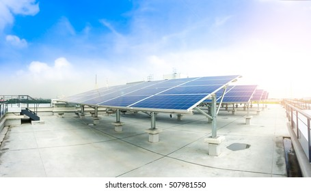 Soft focus of Solar panels or Solar cells on factory rooftop or terrace with sun light, Industry in Thailand, Asia. Can saving energy. Sun or renewable or Clean energy.