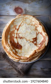 Soft focus. A stack of pancakes on a plate. Maslenitsa.
