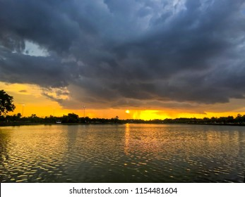 Soft focus to Storm clouds before the rain and colorful dramatic blue sky at sunset before storm in evening have reflection of Nong Prajak Public Park Ud onthani Thailand.Landscape Nature HDR Tone.