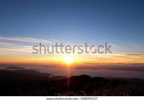 Soft focus of sunris on Doi Pha Hom Pok peak mointain at chiangmai province, thailand