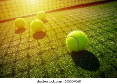 soft focus of tennis ball on tennis grass court with sunlight