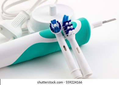 Soft focus toothbrush electric, Dental care tools on white background.