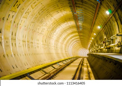 Soft focus of Underground tunnel infrastructure.Transport pipeline by Tunnel Boring Machine for electric train subway .