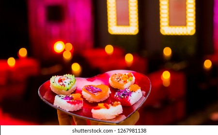 Soft Focus Valentines Day Heart Shaped Sushi Platter with Love lights in the background
