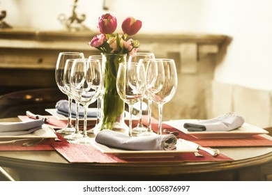 Soft focus vintage tone, Empty glasses and flowers in restaurant  blurred style for the soft background.