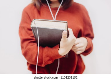 Soft focus of Woman holding the holy bible and headphones,Concept listen the words of God