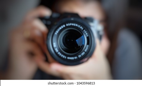 Soft focus of women photographer hold camera and taking a photo.