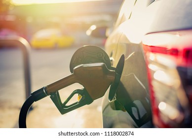 Soft focus,Fuel nozzle to refill fuel in car at gas station,copy space.