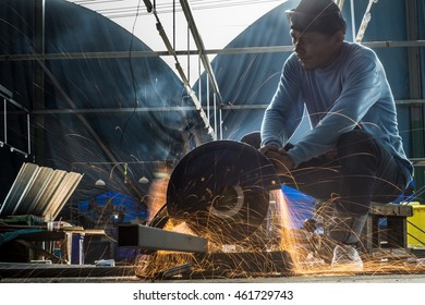 Soft focus,Selective focus,Factory worker using electric grinder - a series of METAL INDUSTRY