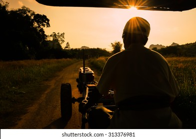 soft focus,silhouette of a man with tractor.art tone