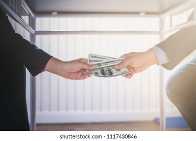 Soft Focus,Young businessmen are filing money with a large approval authority to facilitate a company's investment, bribing a corrupt, misbehaving official who is guilty of misconduct.