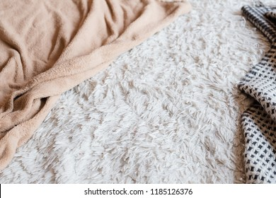 soft furry fabric background. cozy fleece blanket. crumpled bed cover. bedroom sleep and comfort concept. copy space.