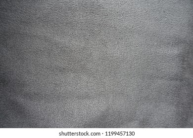 Soft grey artificial suede fabric surface from above