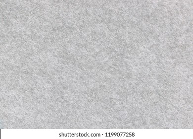 Soft grey felt material.Surface of felted fabric texture and abstract background. High resolution photo.