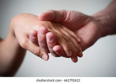 Soft holding hand.