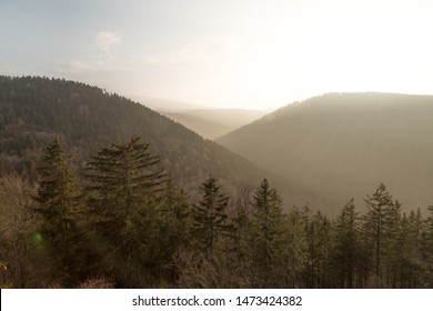Soft light of the evening sun over the mountains of the Harz