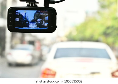 Soft light and selective focus image of view through the front glass of the car with a car video recorder.CCTV car camera for safety on the road accident.