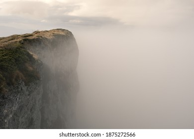 Soft, misty, moody view of fog covered Trem summit, the highest peak of Dry mountain (Suva planina) in Serbia