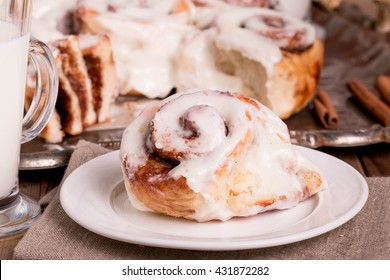 Soft, Moist and Fresh Homemade Cinnamon Buns. Cinnamon Rolls with Cream Cheese Icing for Breakfast.