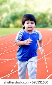 Soft and motion blur boy is running in morning sunlight on racetrack background.