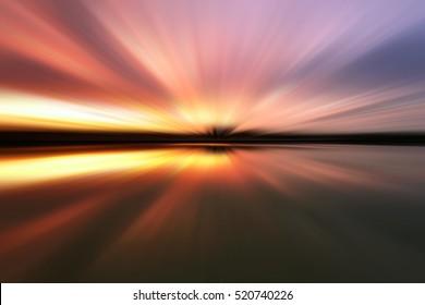 Soft motion blur sunset for background.