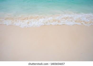 Soft ocean wave on sandy beach
