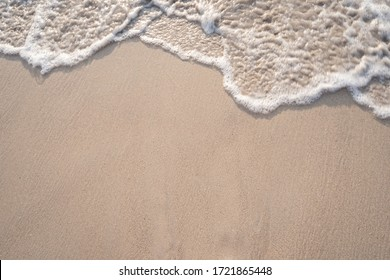 Soft ocean wave on tropical sandy beach in summer background with copy space