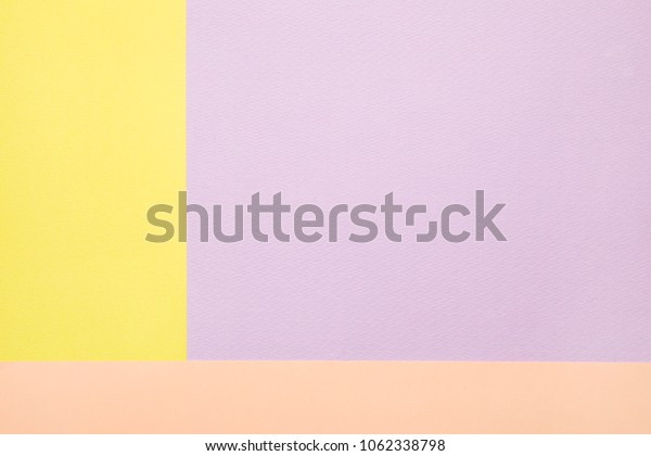 soft pastel colored paper background.