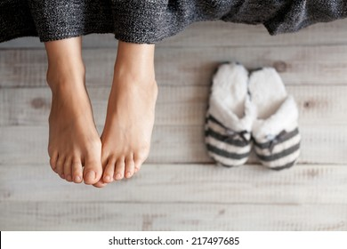 Soft photo of woman feet with slippers, top view point