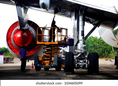 Too soft photography of aircraft mechanic working on the lift a loft.
