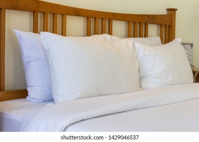 Soft pillows on comfortable wood bed. interior bedroom