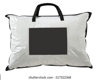 Soft pillows in a plastic bag against white.
