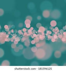 Soft pink bokeh on dark teal background