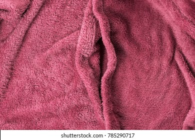Soft pink fabric shaped as female genital organs, vagina