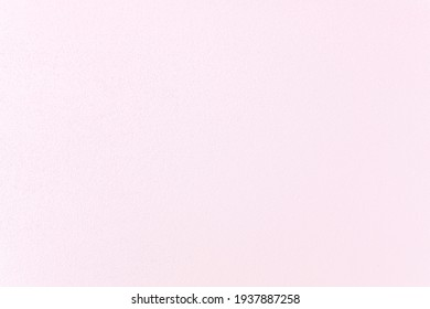 Soft pink pastel cement wall texture for background.