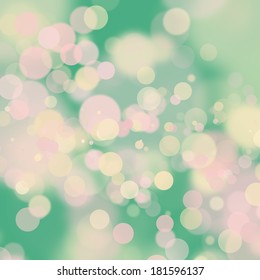 Soft pink and yellow bokeh on green background