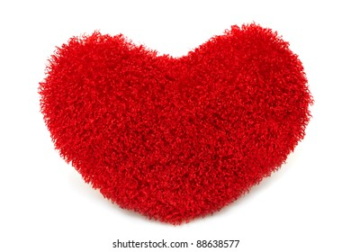 Soft red heart pillow isolated on white background