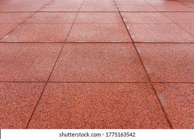Soft rubber tiles on the Playground