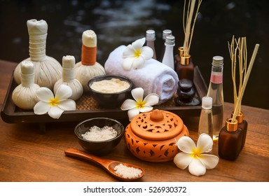 Soft and select focus Spa massage compress balls, herbal ball and treatments spa on the wooden; Spa Thailand.