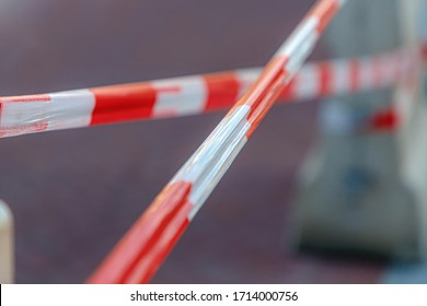Soft selective focus barricade tape, Brightly colored tape in white and red, Keep people way from closed area, Outdoor construction, Street renovate.