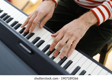 soft selective focus, european, caucasian man playing the piano. Music lesson, musician, pianist, love music