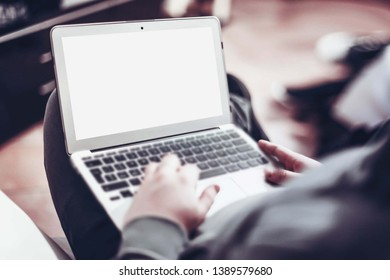 Soft and selective focus a man working on laptop with blank white screen