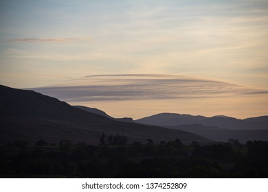 Soft serene mountains purple in evening sunset. Troutbeck, Lake District, UK. October.