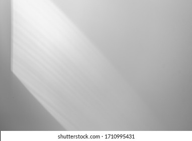 Soft shadow on wall, abstract lines by sunlight on wall, background