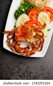 Soft shell crab, deep fried in tempura and served with shrimp fried rice, scallions and pickled vegetables.  Classic Vietnamese, Japanese or Chinese entree.