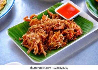 Soft shell crab Fried with chilli sauce Blue background. Thai seafood.