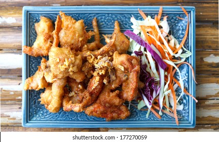 Soft Shell Crab fried with garlic on plate in restaurant.