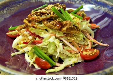 Soft shell crab salad on blue store plate